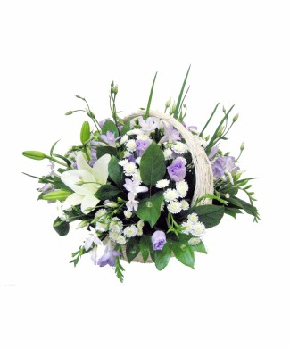 flowers in basket of white roses and lillies