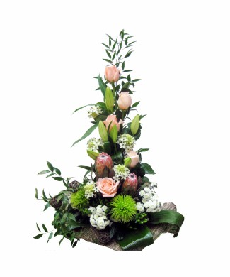 corporate floral arrangement of roses and prothea