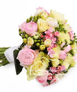 bouquet for wedding of single-headed roses, ranunculus and freese