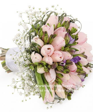 bridal bouquet of cream and purple tulips