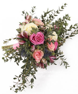 bridal bouquet of various kinds of roses, alstromeries and eucalyptus