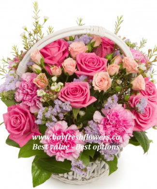flower basket of different kinds of roses and carnations