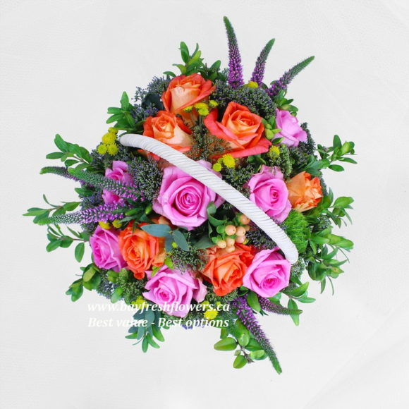 bouquet of pink and orange roses in a hat box