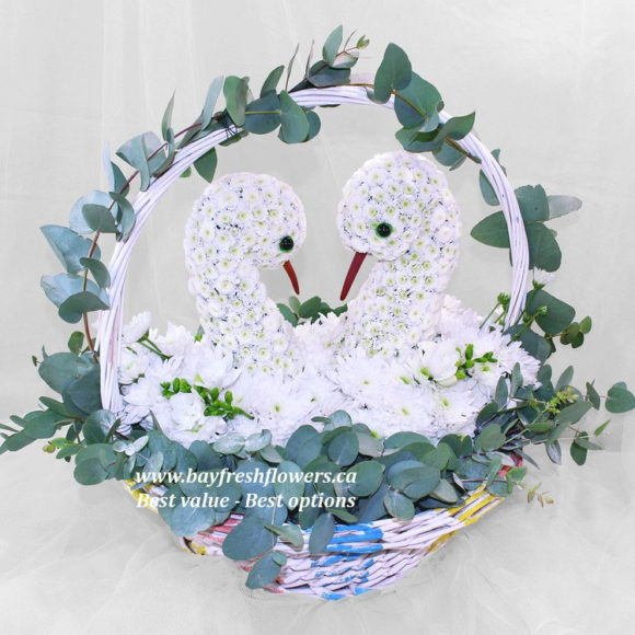 flower basket with pair of swans from flowers