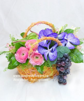 flower basket of red roses and blue orchids