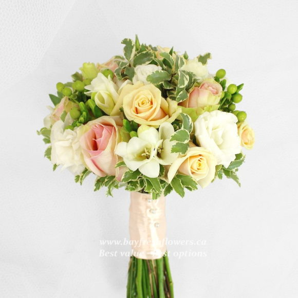 wedding bouquet of roses and freesias