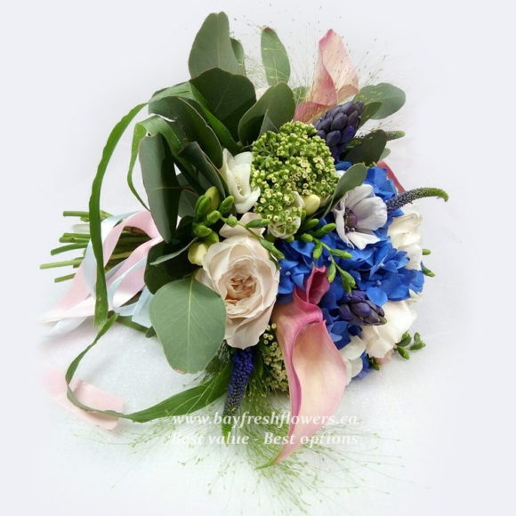 bouquet for wedding of roses, calla and hydrangea