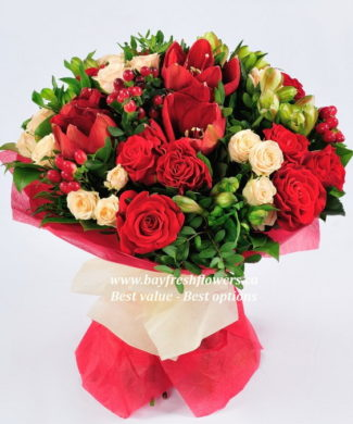bouquet of cream and red roses and amaryllis