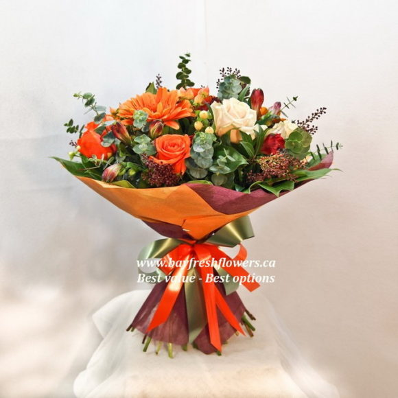 bouquet of red and cream roses and gerberas