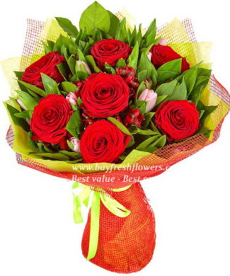 bouquet of red roses and pink tulips