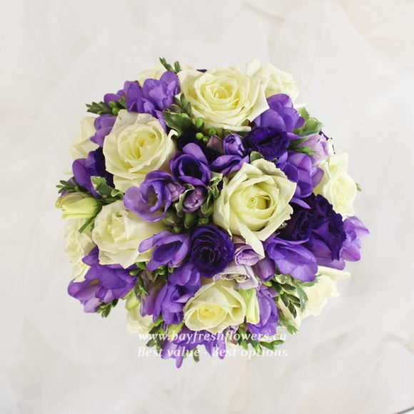 bouquet for wedding of cream roses and irises