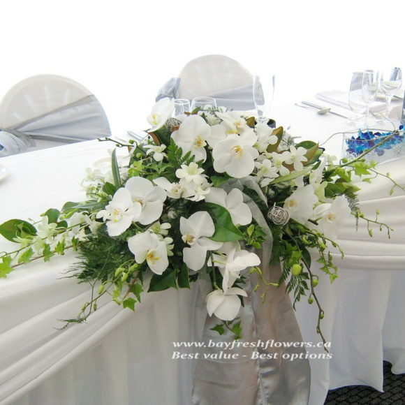 Wedding flowers and centerpieces with white orchids