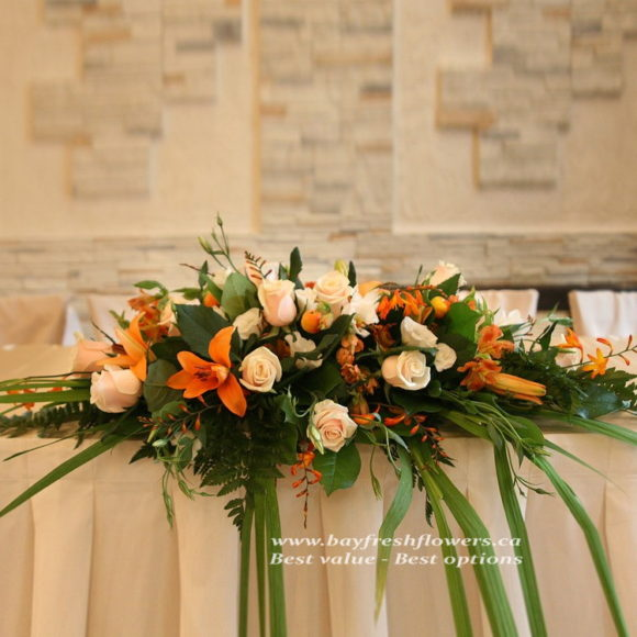 Wedding flowers and centerpieces in cream-orange colors