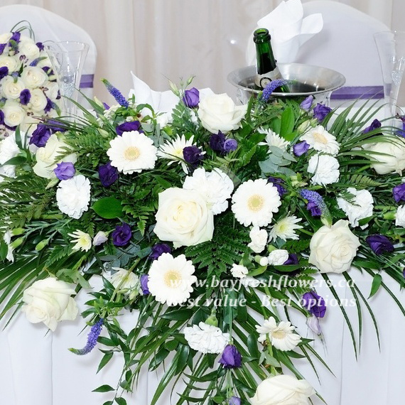 Wedding flowers and centerpieces in white-blue colors