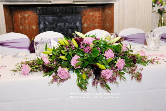 wedding flowers and centerpieces of hot pink roses