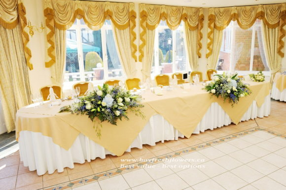 Wedding flowers and centerpieces with hydrangea and lilies