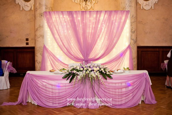Wedding flowers and centerpieces in cream-purple colors