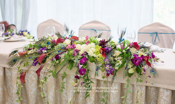 wedding flowers and centerpieces of roses, callas and orchids