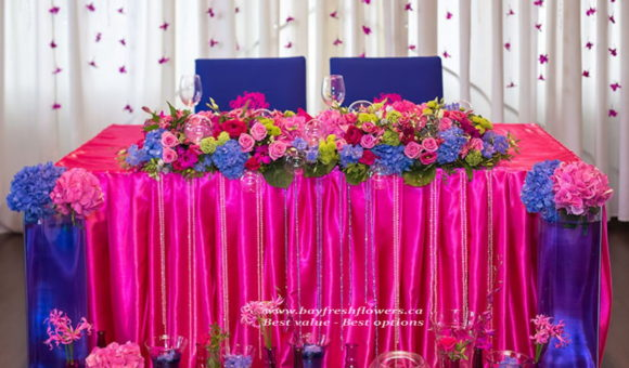 wedding flowers and centerpieces in pinkish blue tones
