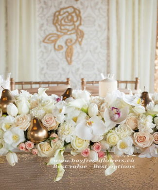 wedding flowers and centerpieces of roses, orchids