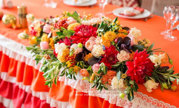 wedding flowers and centerpieces of roses, carnations and asters