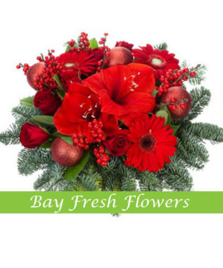 Christmas table centerpiece with red gerberas and amaryllis