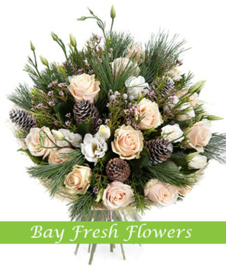 Christmas bouquet of cream roses and freesia