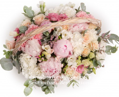 Bouquet of peony, roses and eucalyptus in the basket