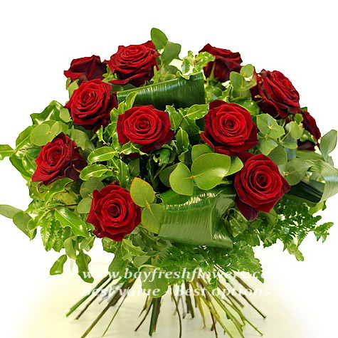 Bouquet of red roses and eucalyptus