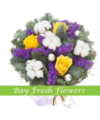Christmas bouquet of yellow roses and limonium