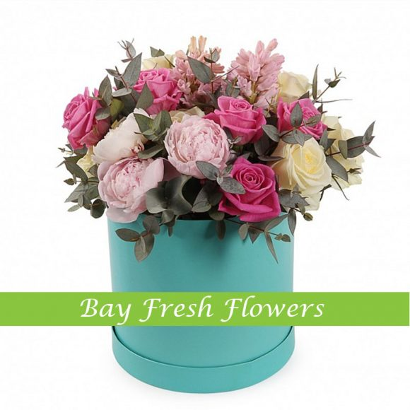 pink peonies in a hat box