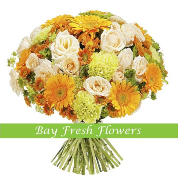 bouquet of peach roses, red gerberas and lime carnations