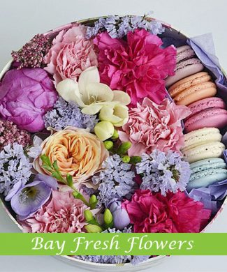 macaroons and peonies, carnations, and freesia