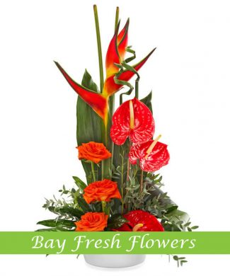 corporate flower arragement of red roses, anthurium and vriesia