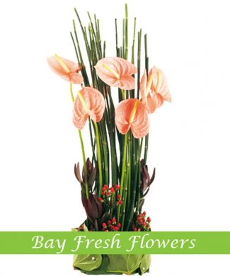 corporate flower arrangement with pink anthuriums