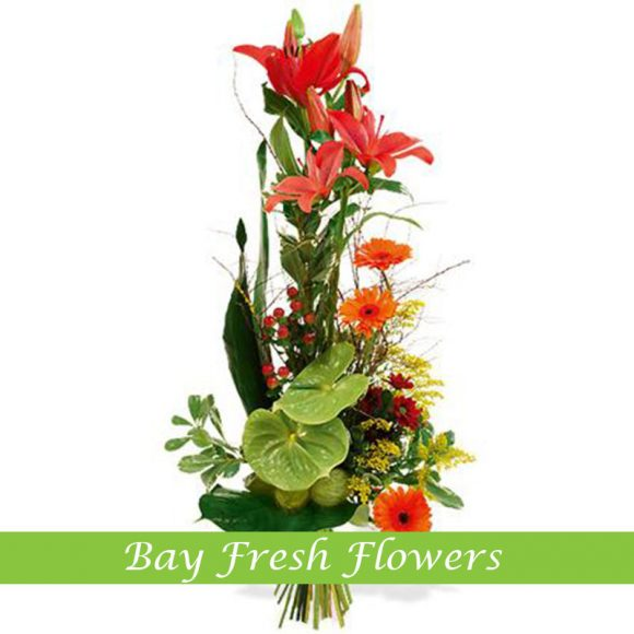 corporate flowers arrangement with red lilies