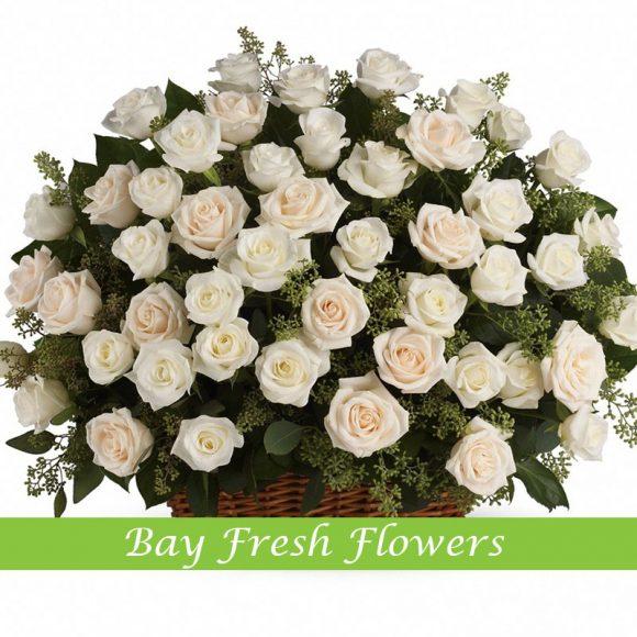 Large sympathy basket of white roses