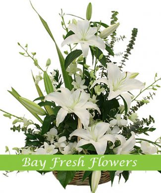 Sympathy arrangement with lilies