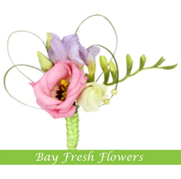 Groom boutonniere of eustomas (lisianthus)