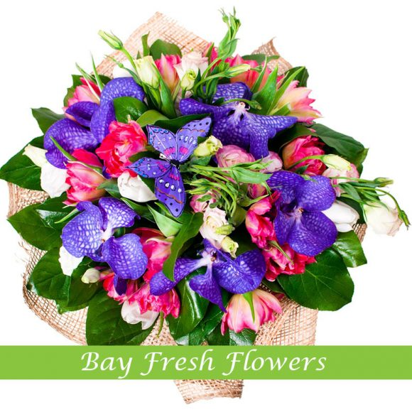 bouquet of pink tulips, white eustomas and purple orchids