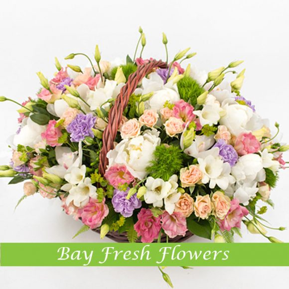 Mix bouquet of flowers in the basket