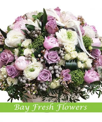 Mix roses and peony flowers in the basket