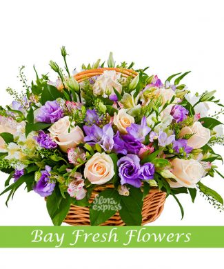 Mix of blue and pink lizantus roses flowers in the basket