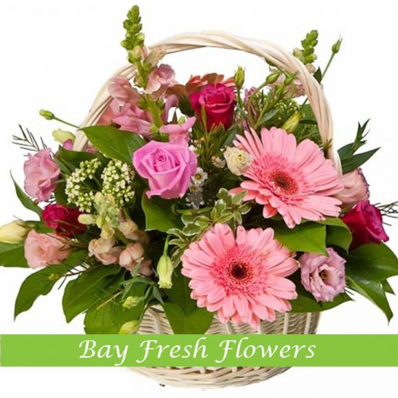 Mix of gerbers and roses in basket