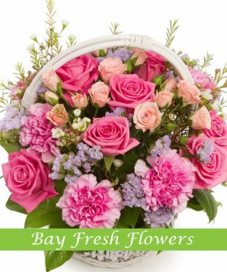 Mixed roses flowers in the basket