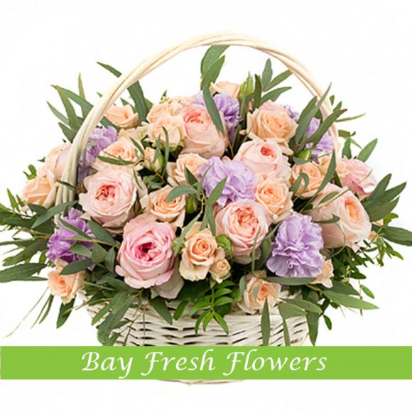Mix of pink roses in the basket