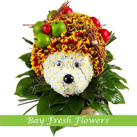 Hedgehog of flowers bears apples