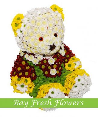 White bear in pants made of flowers