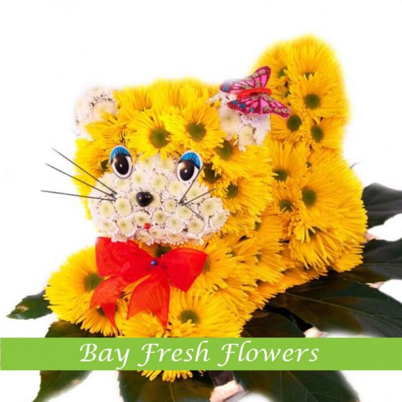 Yellow cat created from flowers
