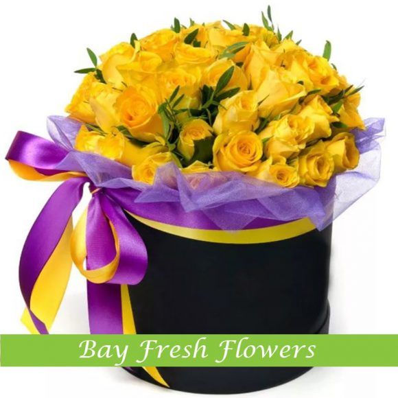 yellow roses in the hatbox